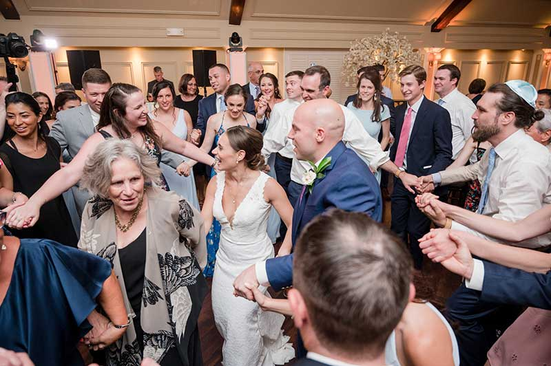 Couple dances to music at wedding from the 2021 wedding song guide