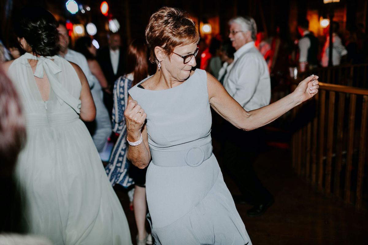 Mother of the bride dances at wedding reception