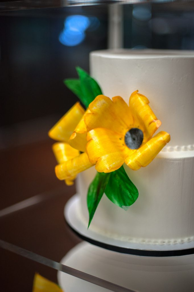 Simple white wedding cake with 2 large 3D yelloe flowers