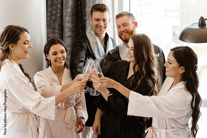 Bridal party toasts with champagne