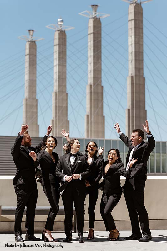 Mixed-gender wedding party in black tuxedos