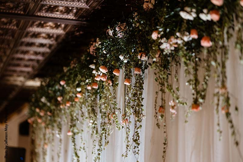 Greenery and floral head table floral installation