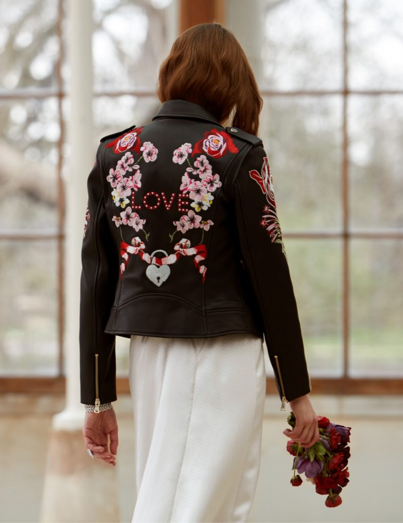 """Black leather bridal jacket stitched with the word """"LOVE"""" and roses"""