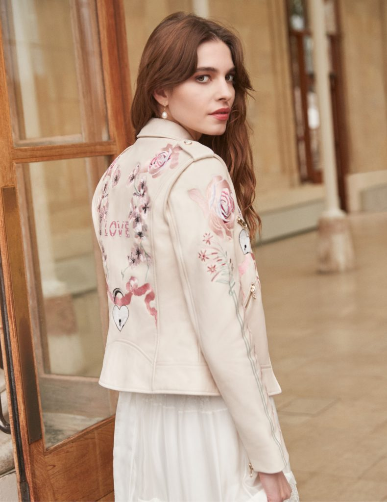 """Blush leather bridal jacket stitched with the word """"LOVE"""" and roses"""