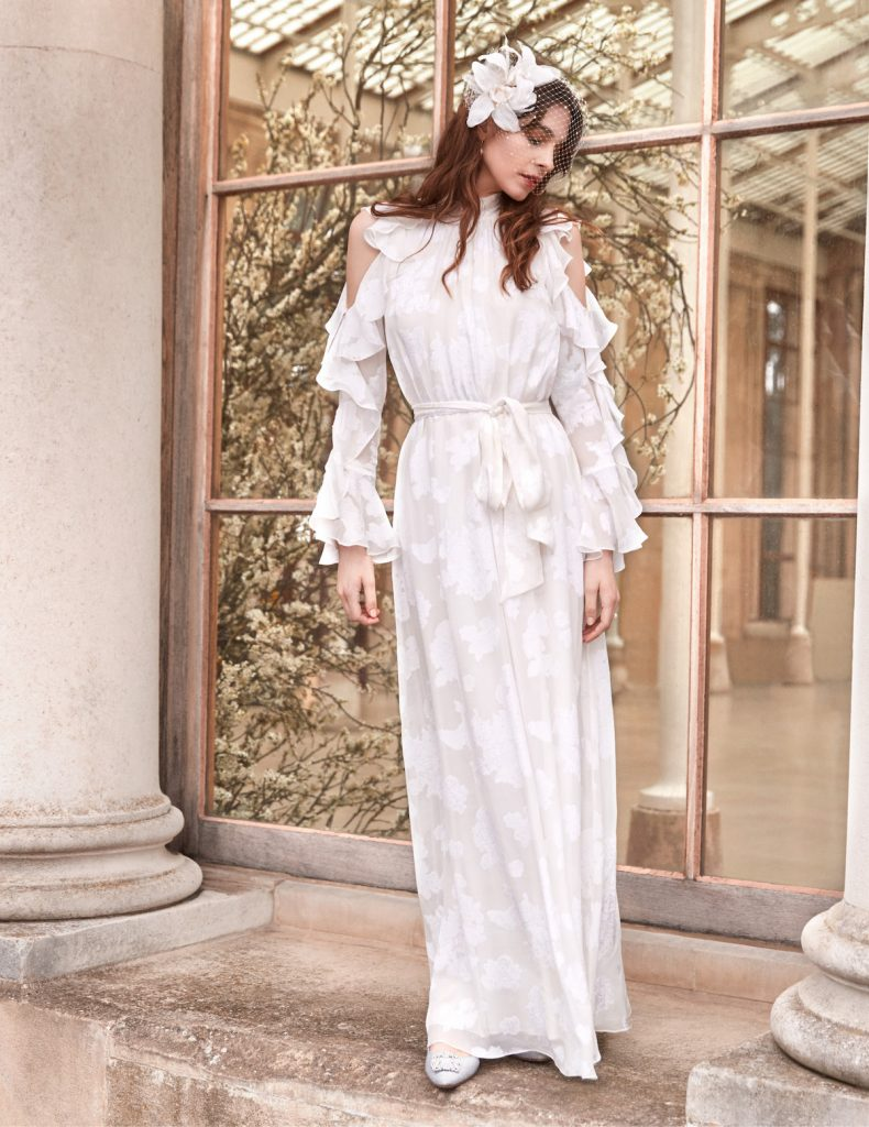 Cut out shoulder flowing long-sleeved bridal gown