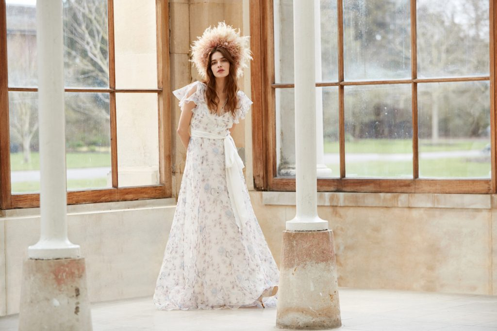 Bridal cap-sleeve gown with flowers