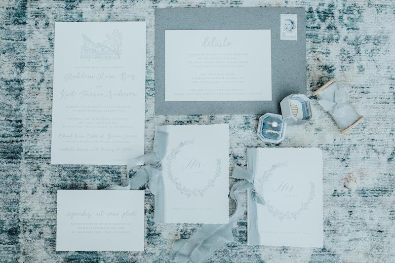 Pale blue and white elegant wedding stationery