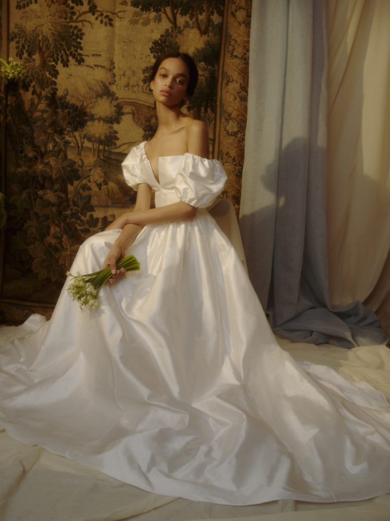 Puff-sleeve bridal gown inspired by the 80's