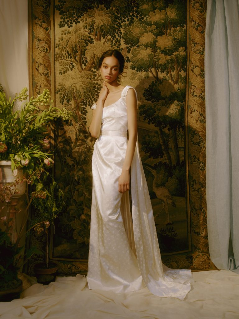 Satin bridal gown with cape