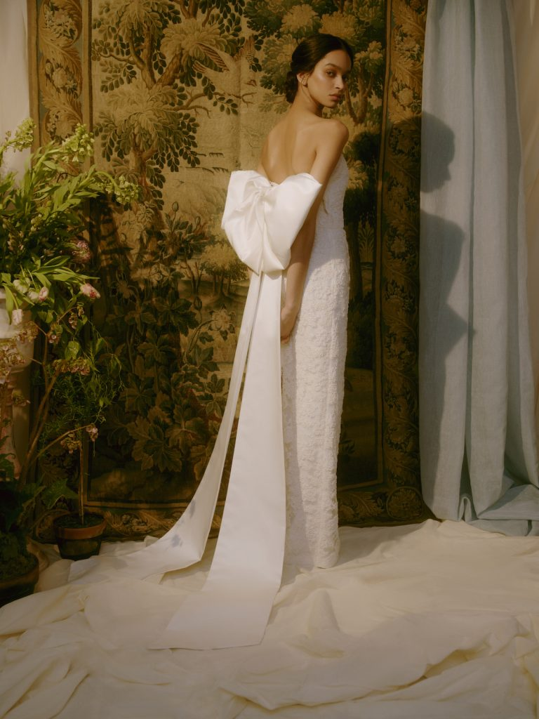 Column bridal gown with large bow in back