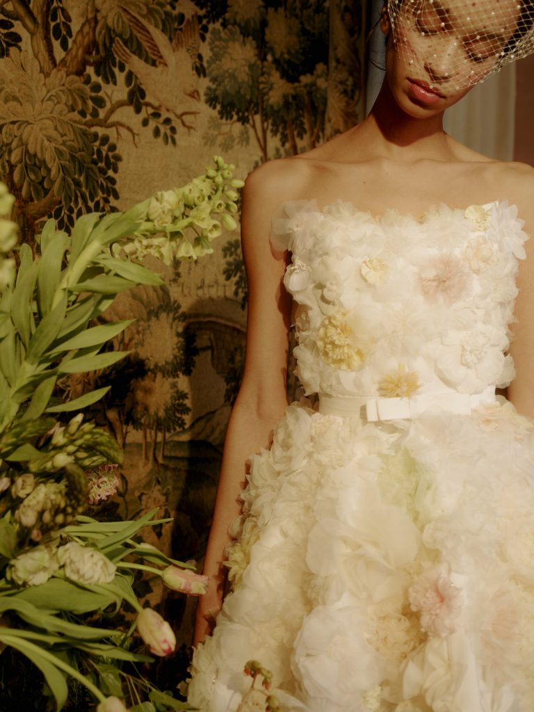 Short bridal gown with floral applique by Markarian