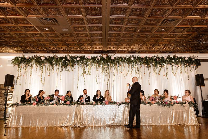 Father of the bride gives speech at modern formal wedding