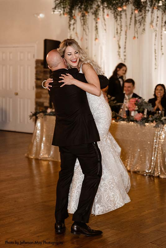 Bride and father share dance after wedding