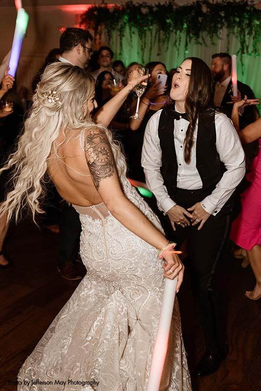 Brides dance at their wedding reception