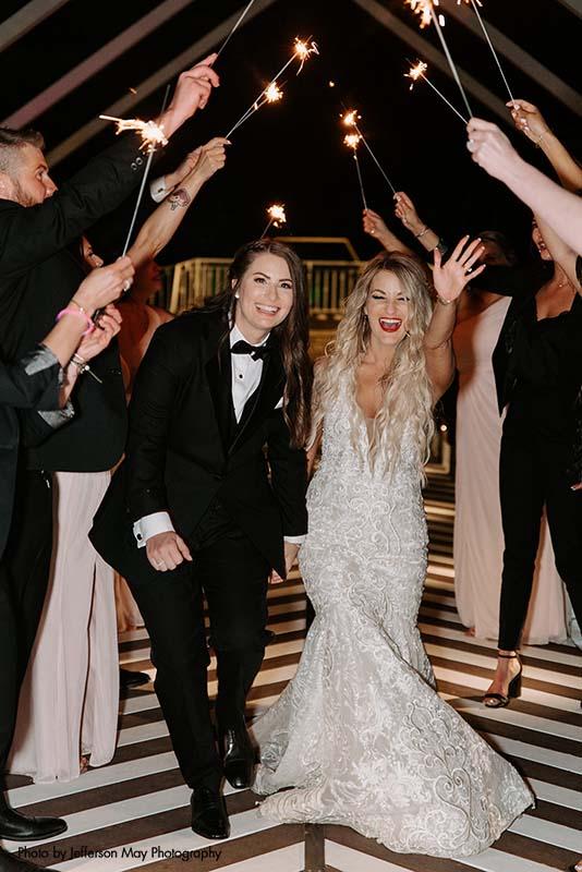 Brides make sparkler exit