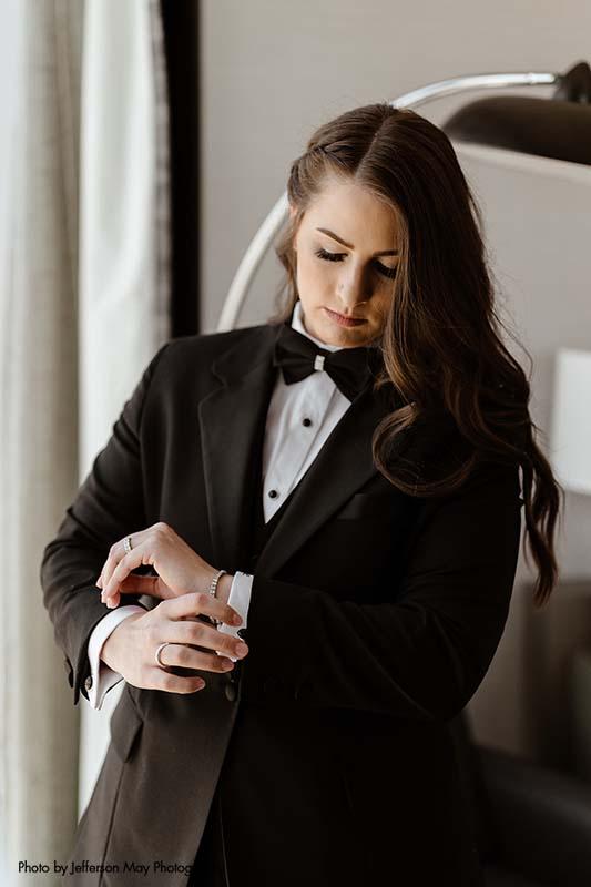 Bride wears custom black and white tuxedo