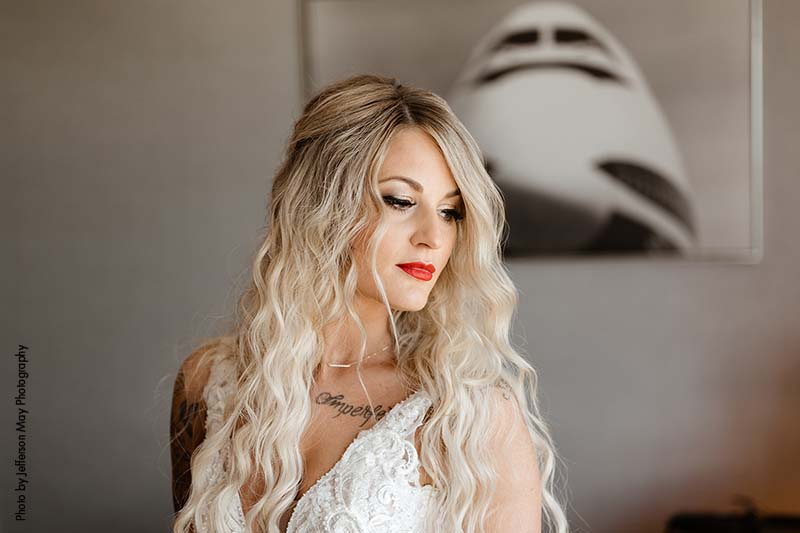 Bride with half-up hair and red lipstick