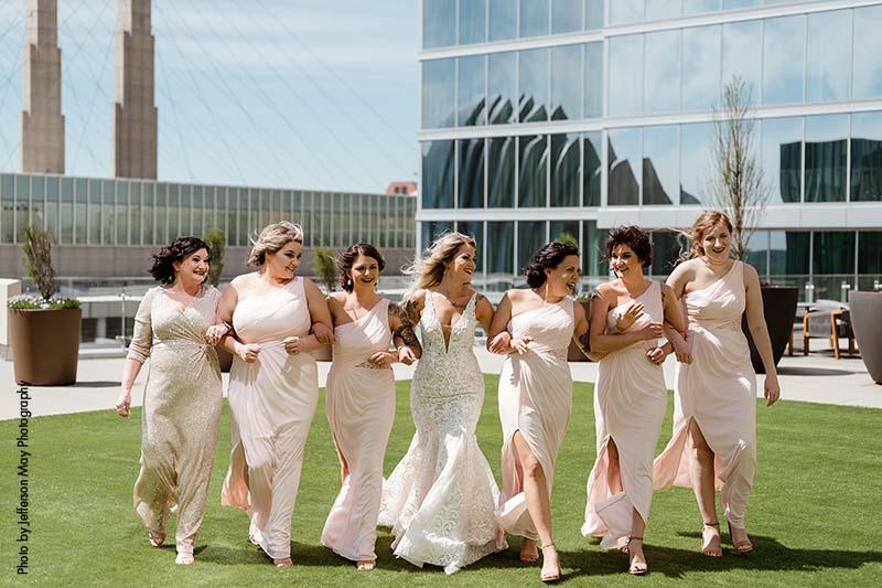 Bridesmaids in light pink dresses