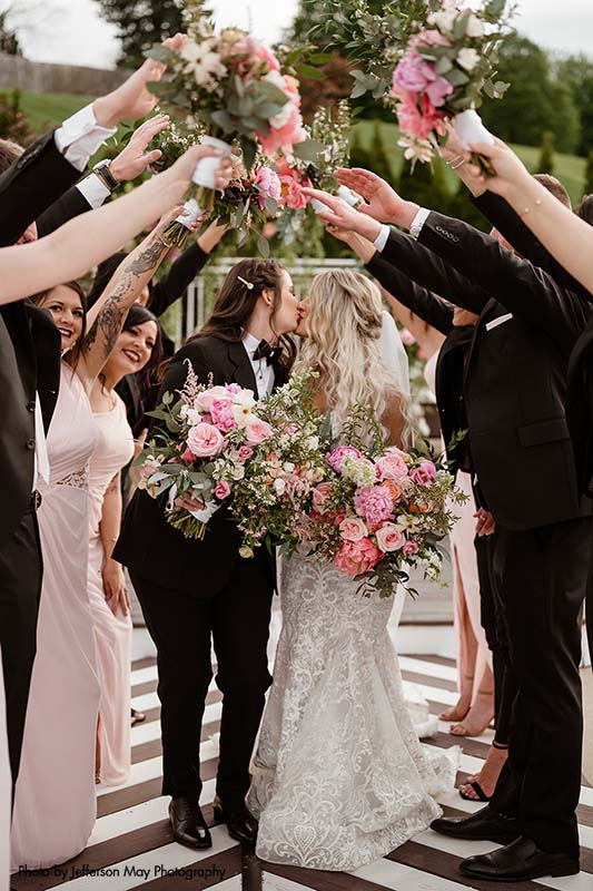 Brides with large pink and white bouquets