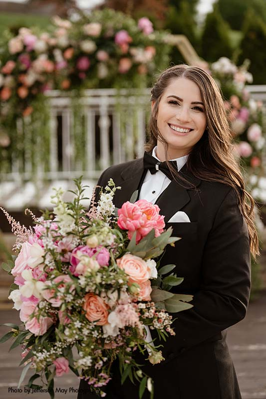 Bride in black suit