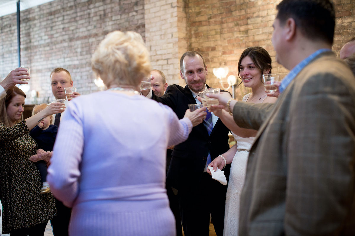 Bride and groom wedding etiquette sharing a toast