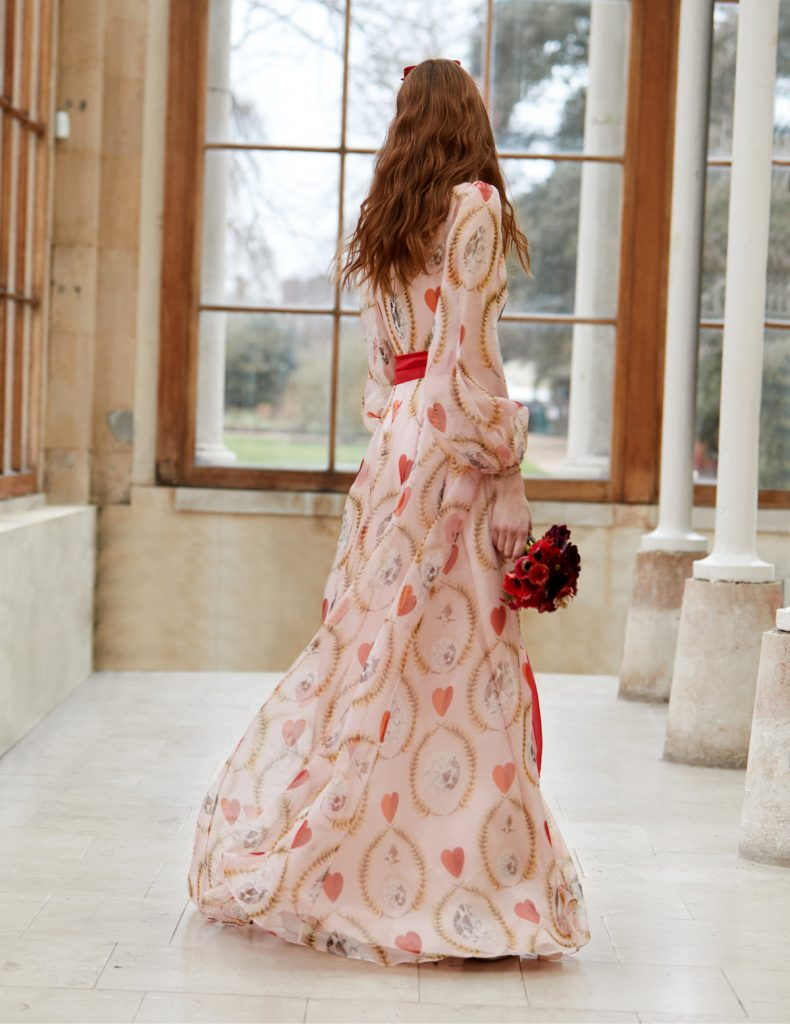 Alternative bridal gown with hand painted hearts, lockets, and ribbons