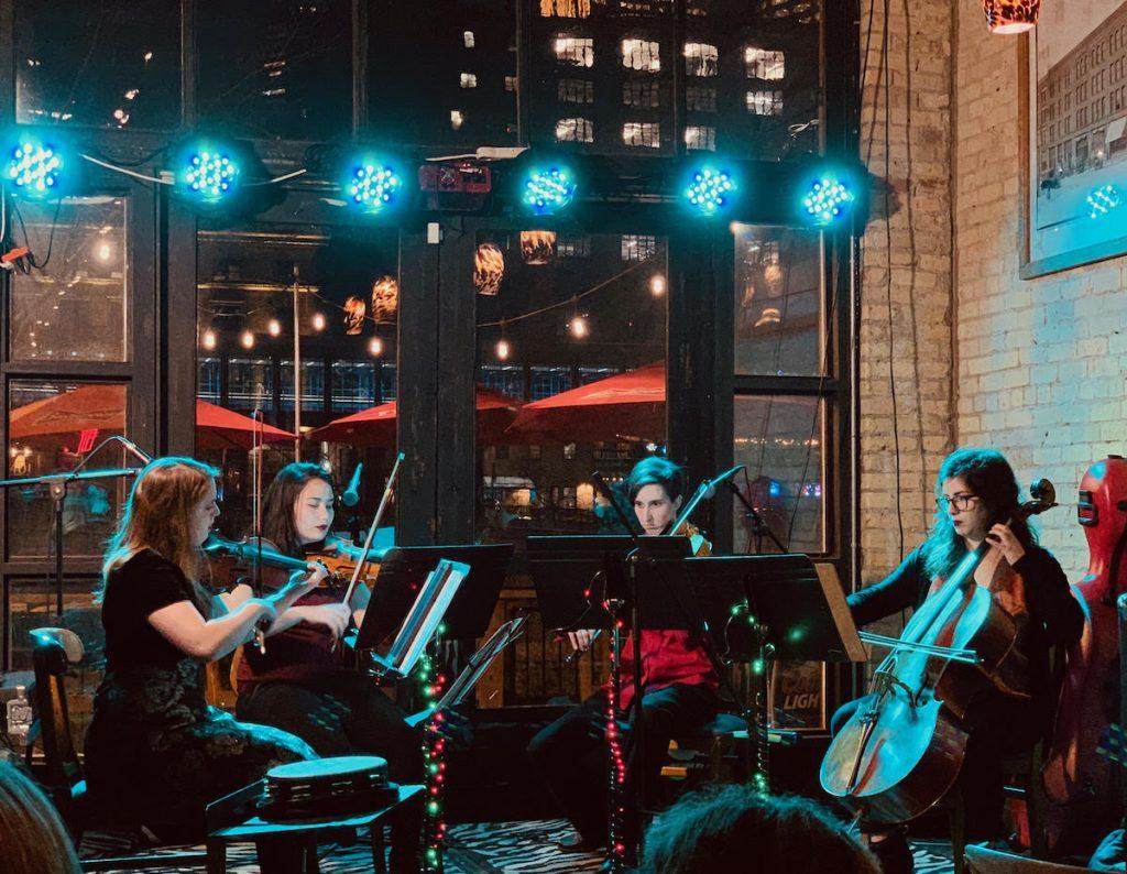Live string quartet plays wedding ceremony songs