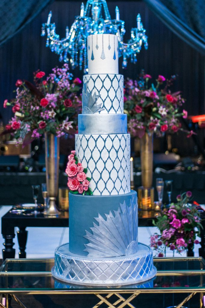 5-tier blue and silver wedding cake with Moroccan patterns and pink flowers
