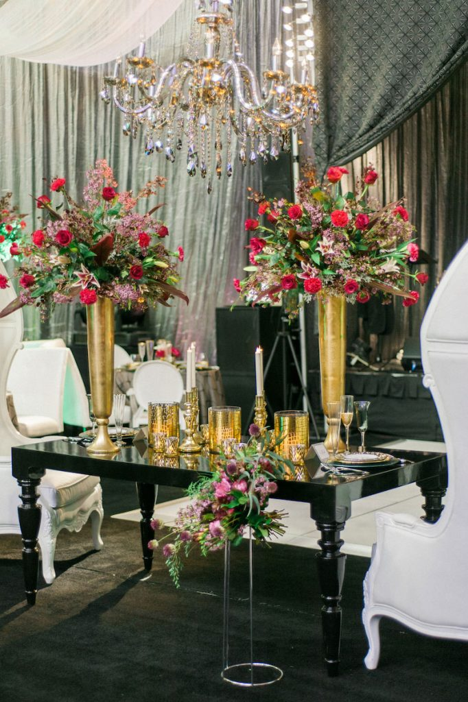 Black lacquer duet table with tall gold centerpieces