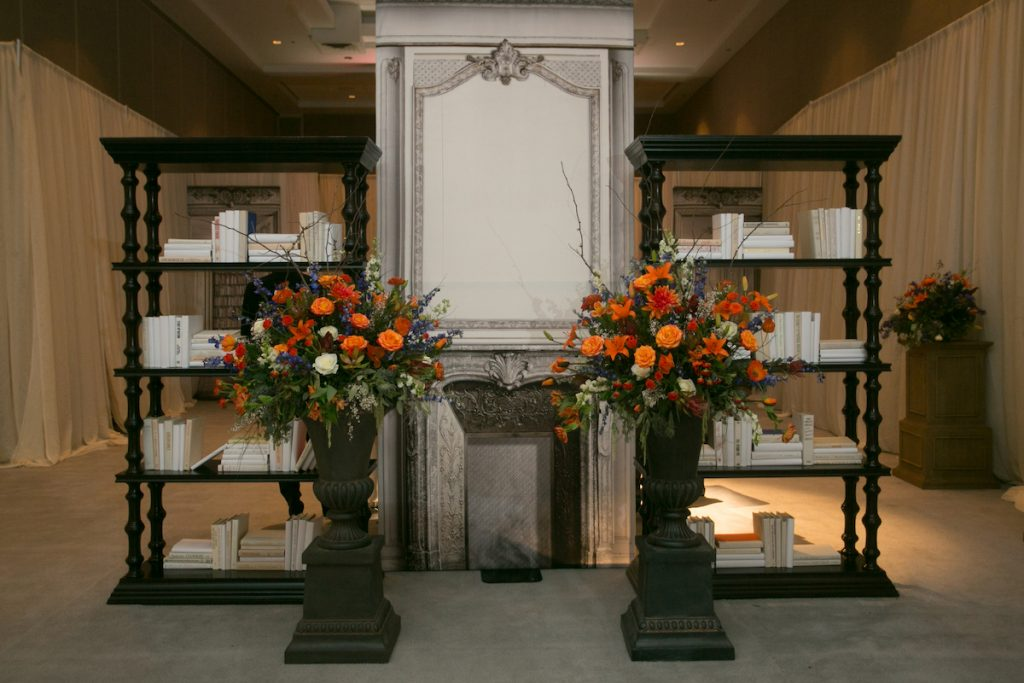 Wedding ceremony alter with bride floral and library panels