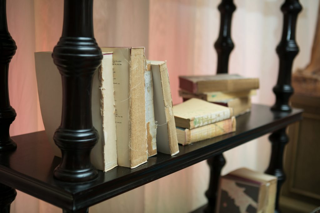 Library themed wedding bar with books on shelves