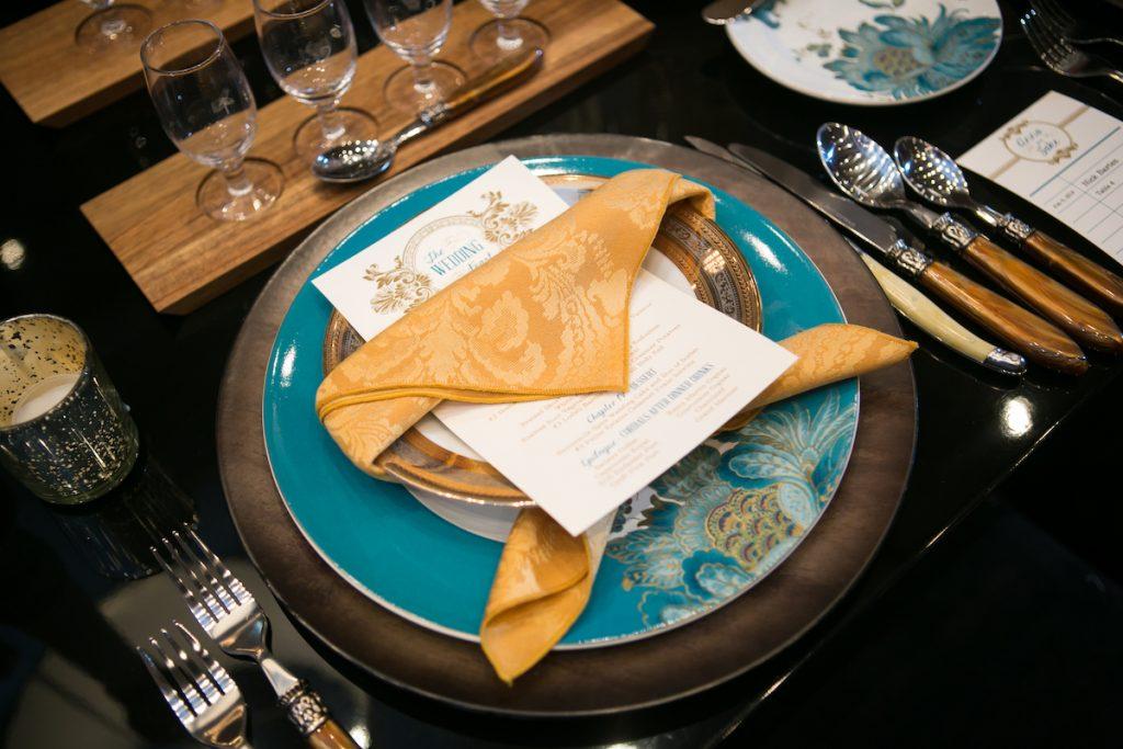 Teal peacock wedding plate with damask napkins
