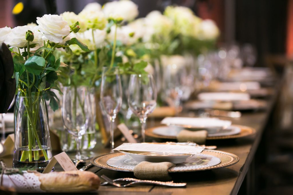 Burlap napkins sit atop baroque wedding plates
