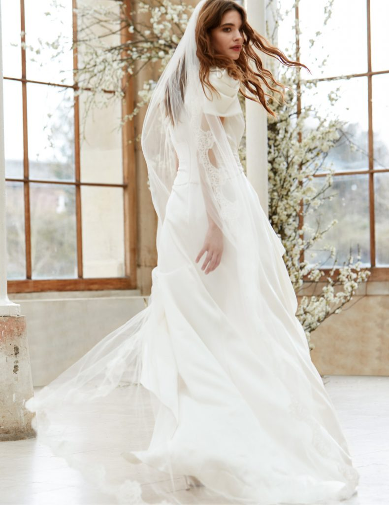 Draped bridal gown with waterfall skirt