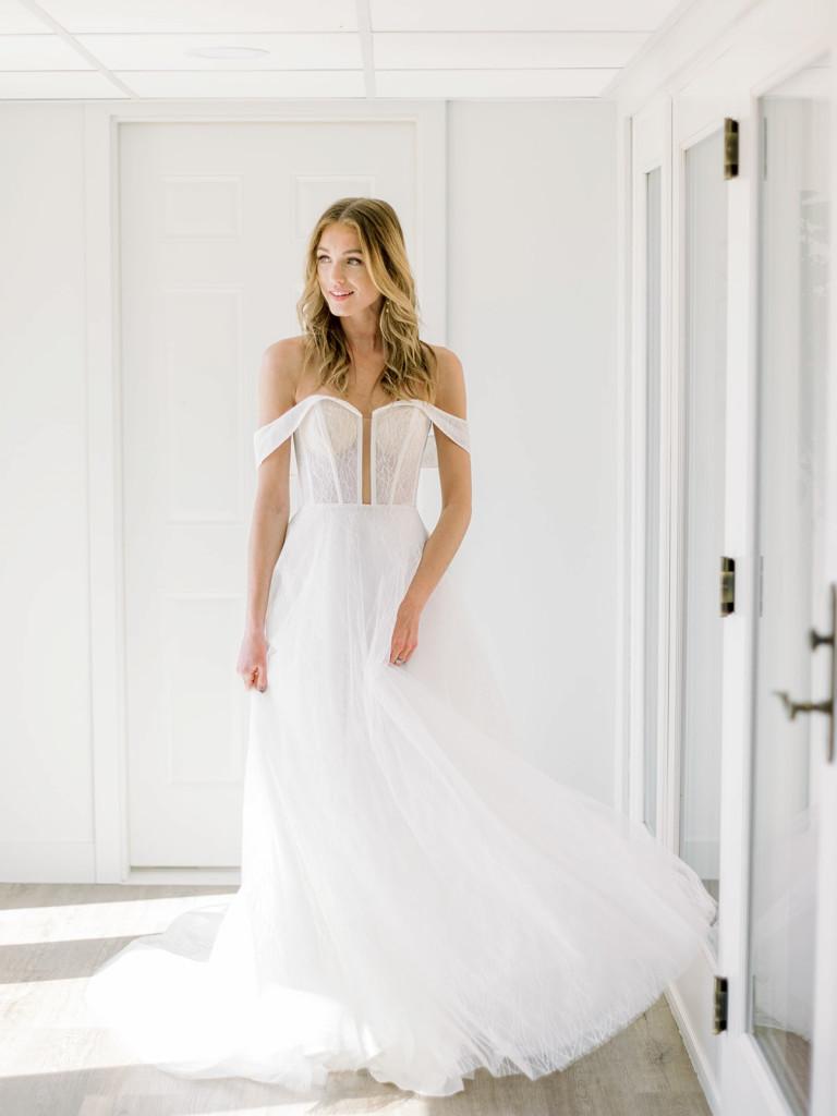 Corset bodice low cut off-the-shoulder bridal gown by Van Der Velde