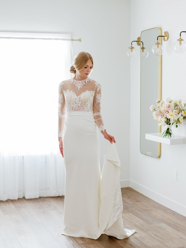 Chantilly lace long-sleeve bridal gown with crepe skirt