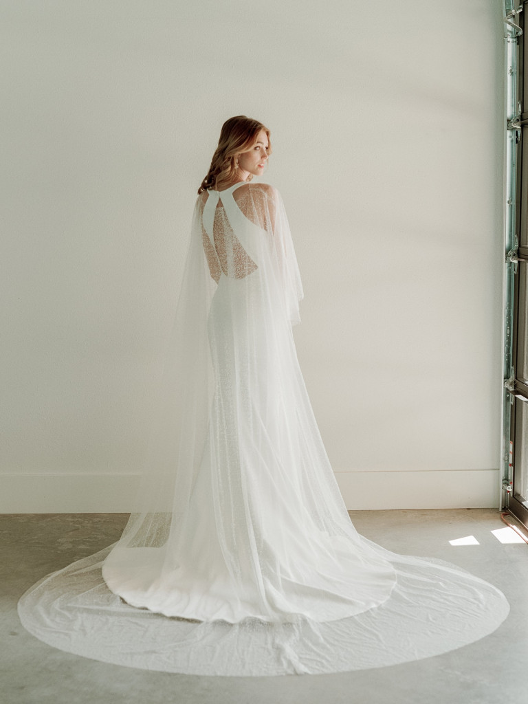 Crepe fit and flare bridal gown with sequin cape