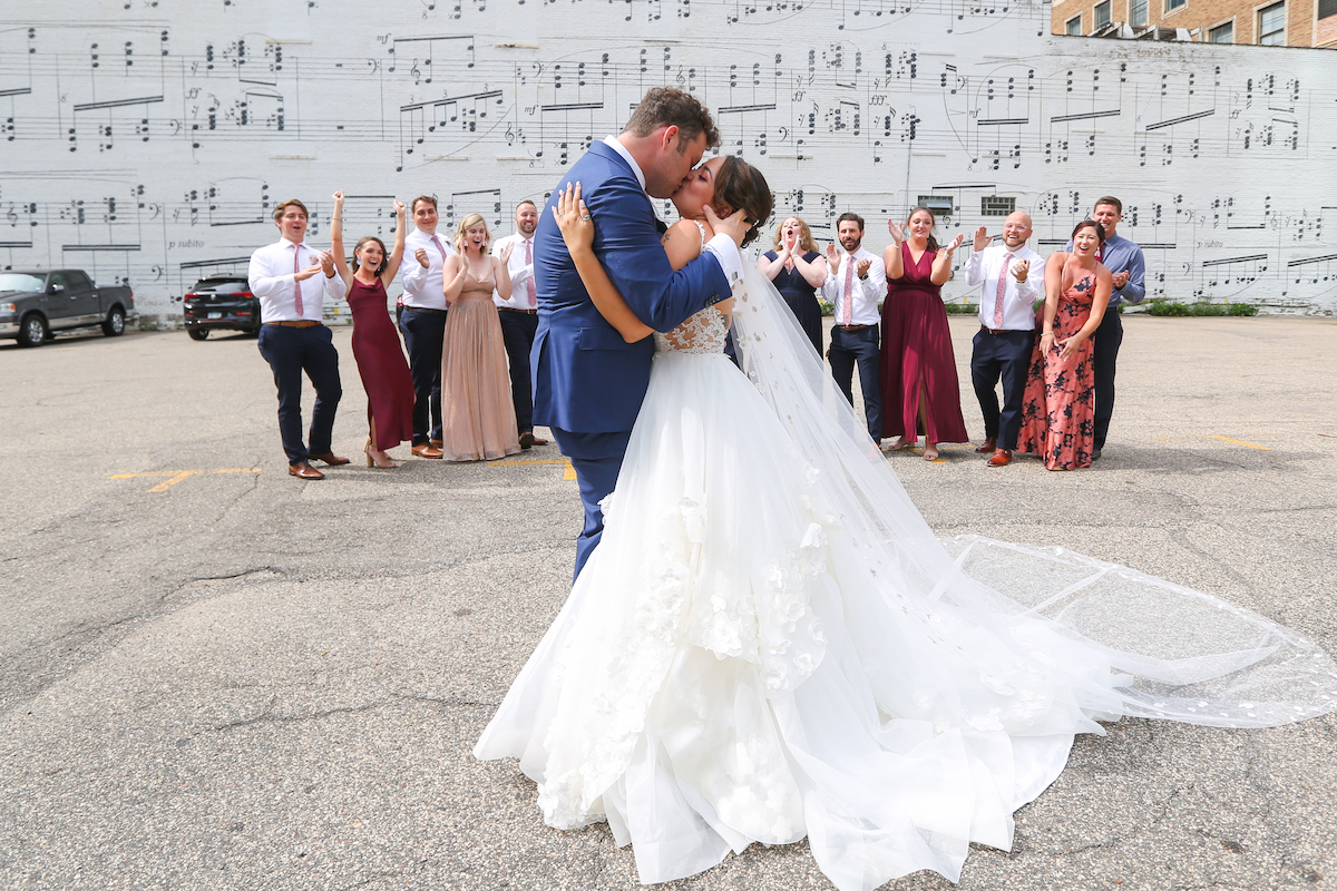 Minneapolis bride and groom in front of music mural