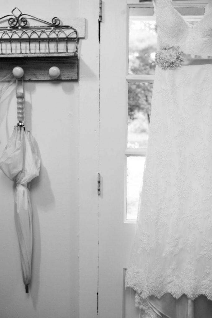 Vintage-inspired wedding dress hangs on a door