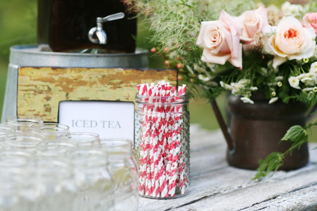 Striped red and white straws at wedding