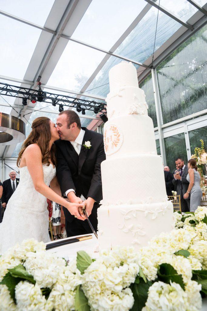 Bride and groom cut 5 food wedding cake with Lebanese sword