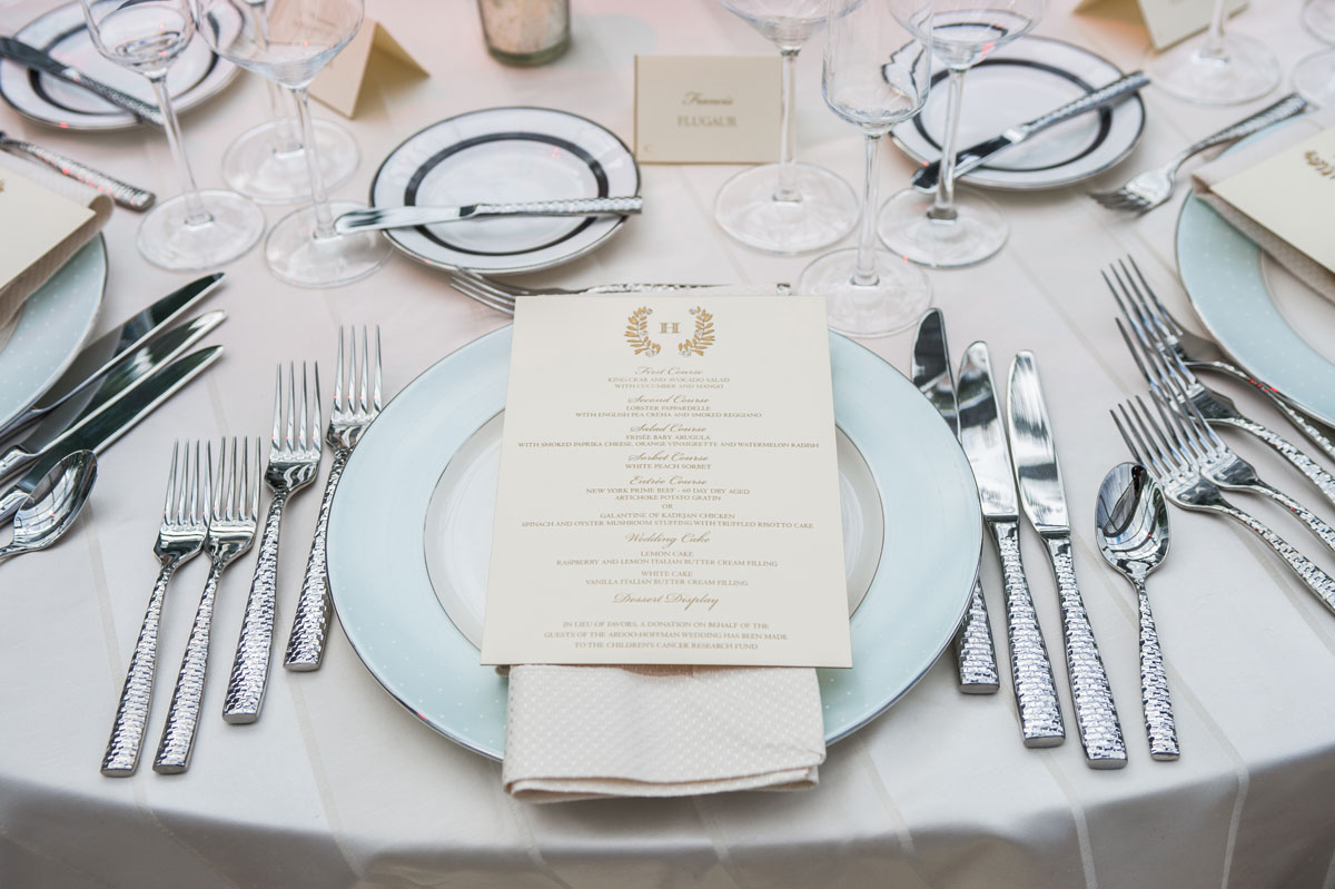 Light blue Monique Lhuillier china with ivory menu laid on top