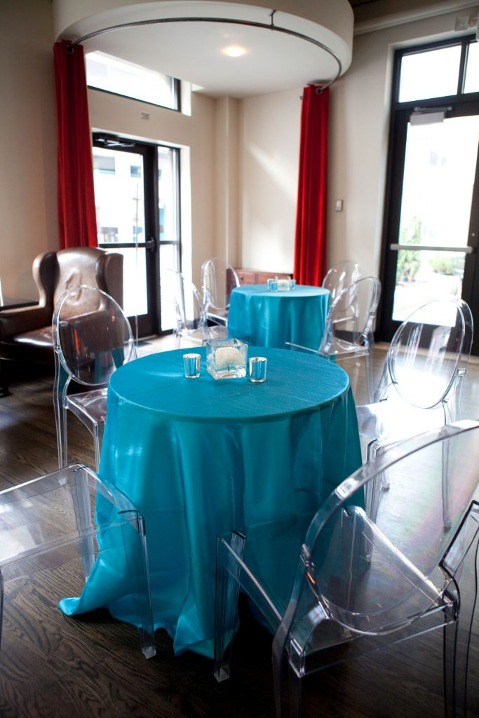 Teal wedding table linens with clear acrylic chairs