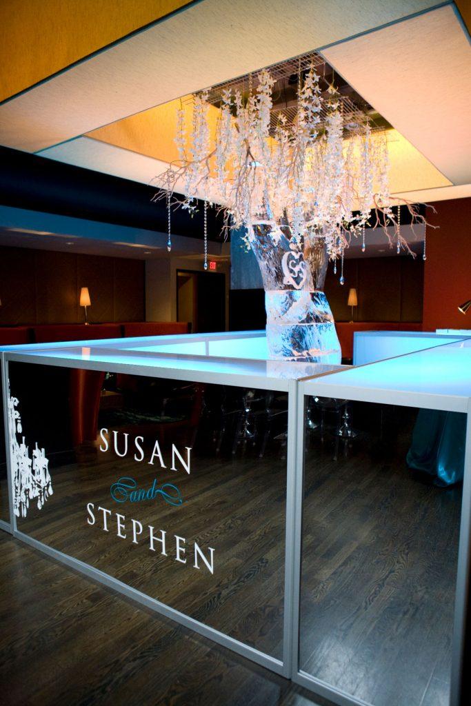 Mirrored acrylic custom bar front at wedding