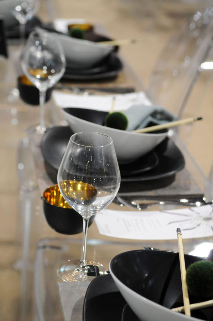 Black and white unique wedding place setting with gold sake cups