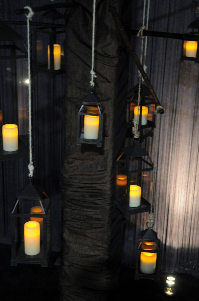 Mini lanterns hang from ceiling at wedding