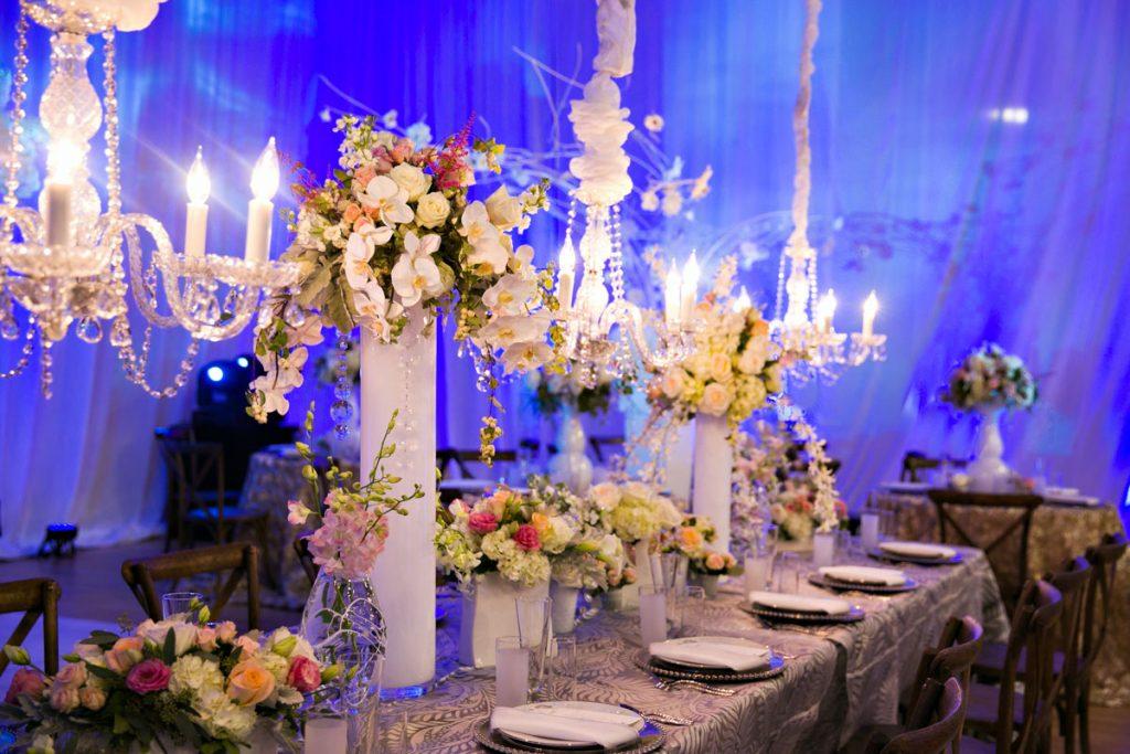 Wedding centerpiece with glossy white centerpiece vases