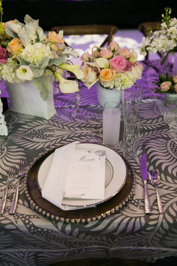 White folded napkin on White china and brown charger