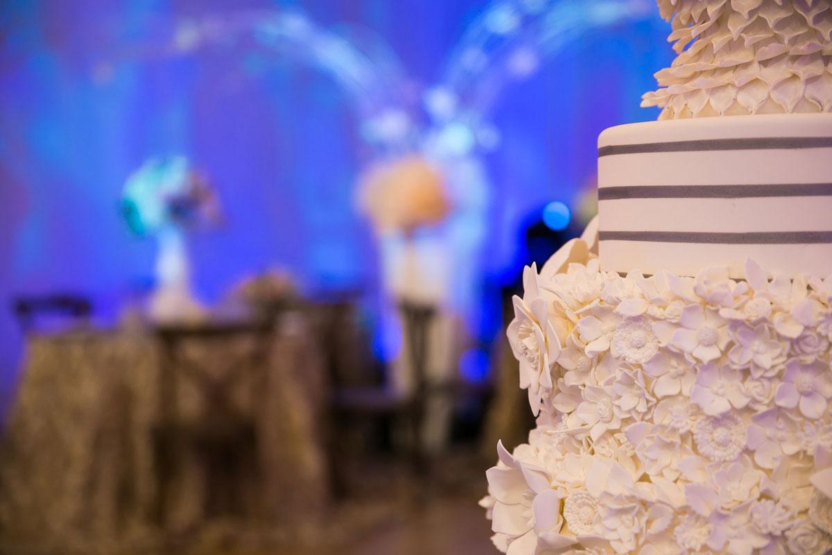 Elaborate white floral multi-tier wedding cake