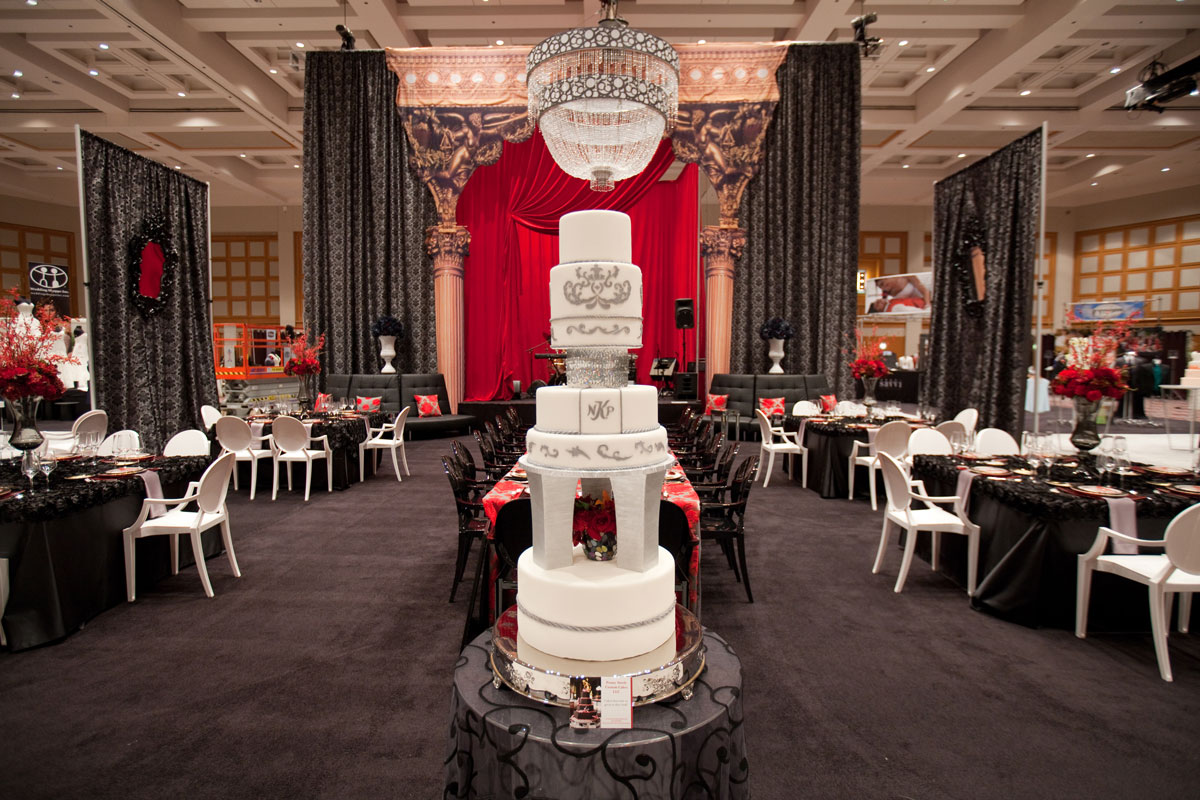 White and silver wedding cake with multiple tiers